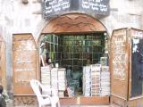 Quran dealer, outside the old city's biggest mosque: no infidels allowed