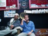 Abdellah, a shop owner by my hotel. One of the nicest men I've ever met. the bag in his lap is full of qat