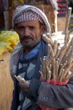 Man selling miswak, a chewing stick