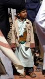 Even young boys wear jambiyas, the traditional Yemeni dagger