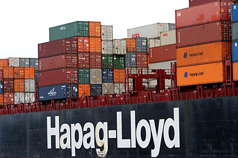Large container ships sail down the Savanna