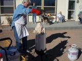 Frank proceeds to baptize the turkey