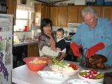 Tomoko & Lisa watch as Frank carves the turkey