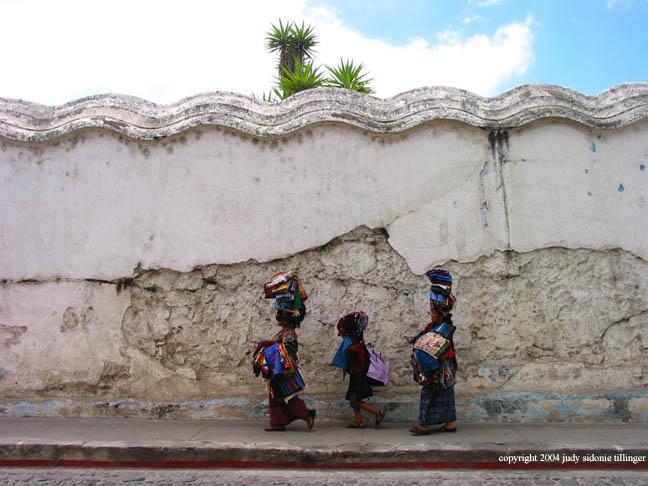 three walking, antigua, guatemala