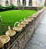 Sweet grass baskets line a street downtown