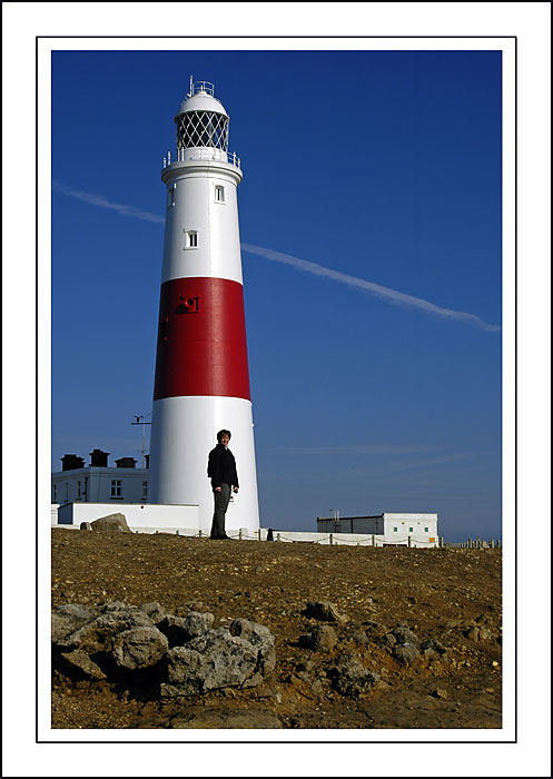 Carole and lighthouse, Portland Bill, Dorset