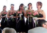 Maid of Honor and bridesmaids wait at the front.