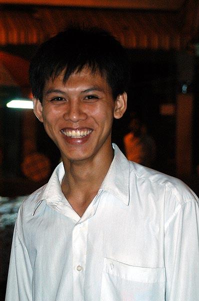 Waiter at open air restaurant,  Ban Thanh Market, Vietnam