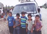 Mulukuku boys by the truck.