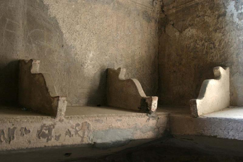 These are the shelves in an apodyterium, or changing room in the bath house. The partitioned shelves are for depositing togas.