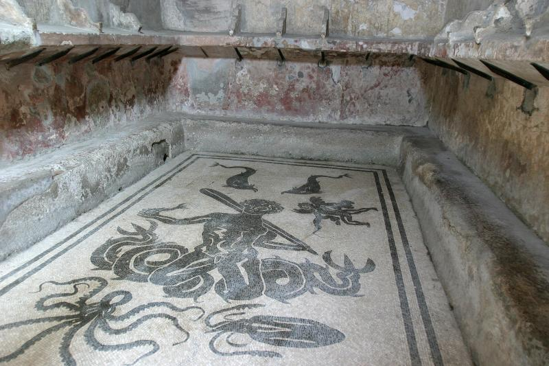 This photo is taken in the mens sector of the Central Baths. The mosaic on the bottom of this pool is Triton - son of Neptune.