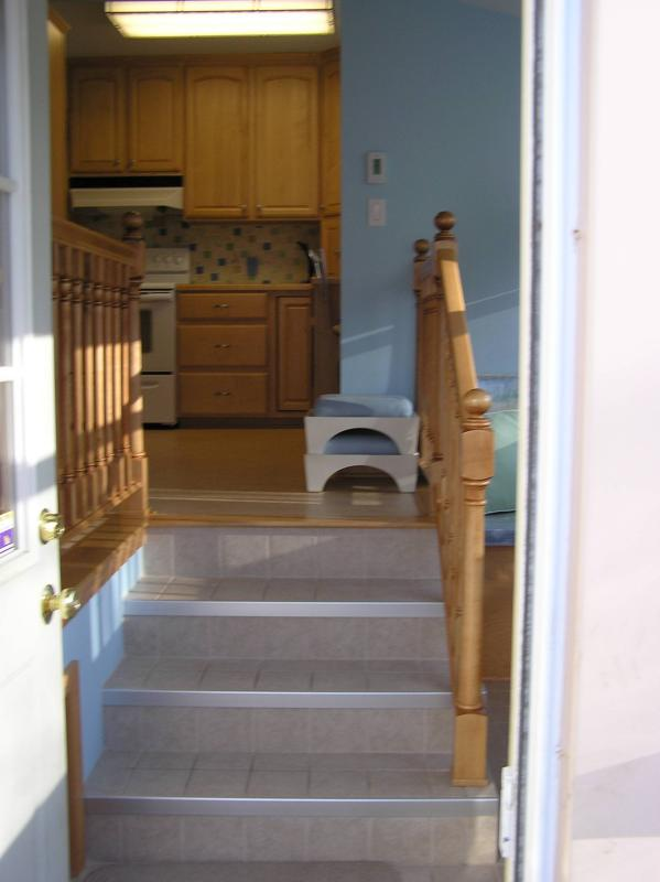Coming in the back door, the new stairs just ahead.