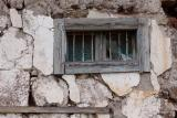 Old window in rough stone wall
