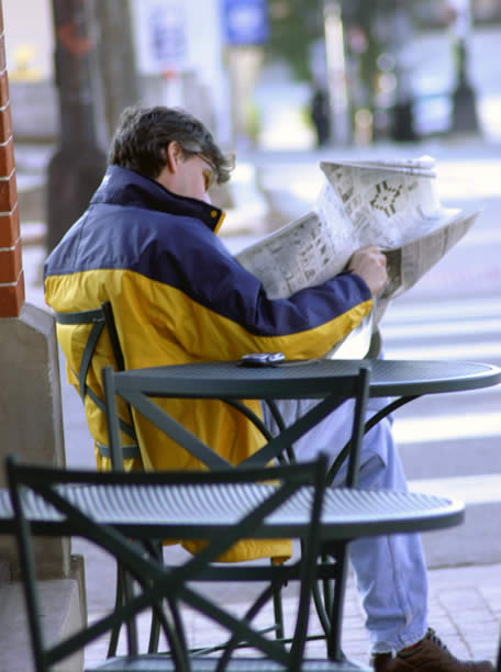 Sweetwaters Cafe - Reading the Newspaper