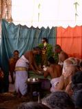 Sarathi adorning tulasi garland