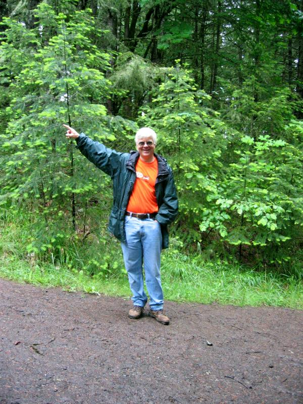 Volunteer pointing the way to Chip Ross Park