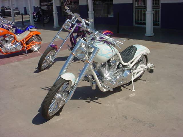 three custom motorcycles