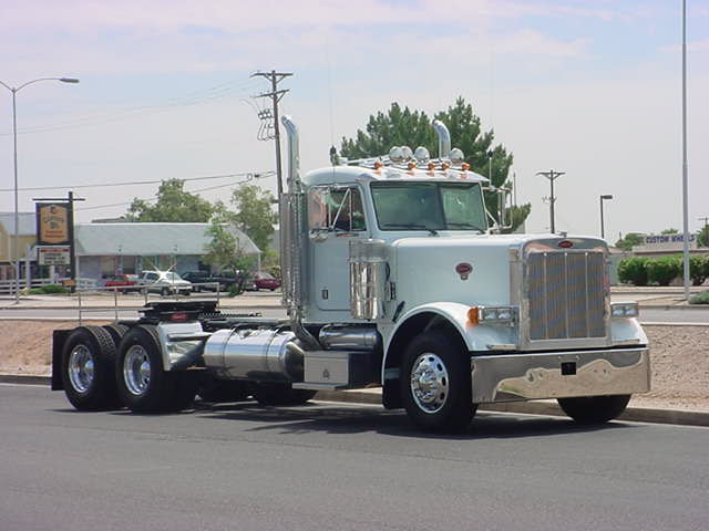 white big rig truck<br>in front of Kats place