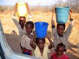 Kids bringing water home