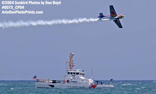 2004 - Red Bull aerobatic aircraft and CGC BLUEFIN (WPB 87318) at the Air & Sea Show - Coast Guard aviation stock photo #0073