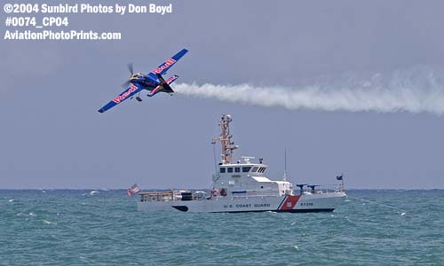 2004 -Red Bull aerobatic aircraft and CGC BLUEFIN (WPB 87318) at the Air & Sea Show - Coast Guard and aviation stock photo #0074