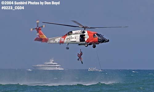 2004 - Coast Guard HH-60J Jayhawk #6025 hoist operation at the Air & Sea Show - Coast Guard and aviation stock photo #0223