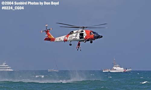 2004 - Coast Guard HH-60J Jayhawk #6025 hoist operation at the Air & Sea Show - Coast Guard and aviation stock photo #0224