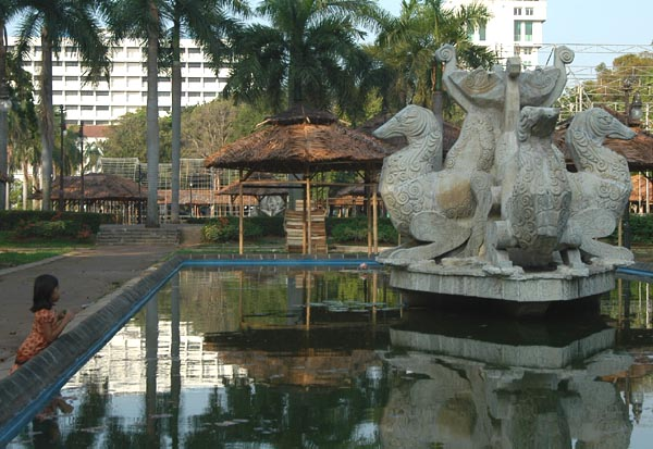 Girl at the fountain in Lapangan Banteng