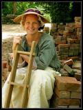 She Makes Bricks