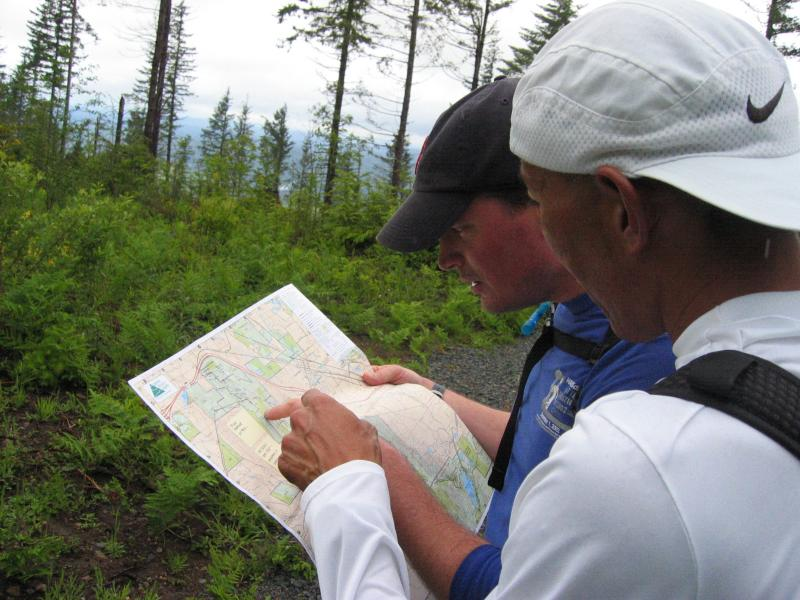 Reaching the power lines, Glenn & Charlie consult the map