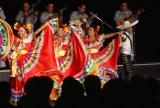 Colorful costumes on the dancers in a Mexican dance troupe on the Wind