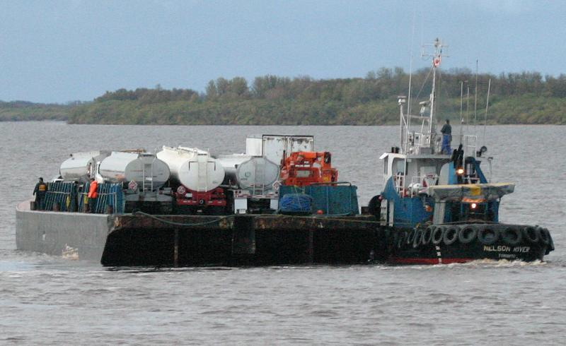 Barge loaded with oil trucks ISO 1600
