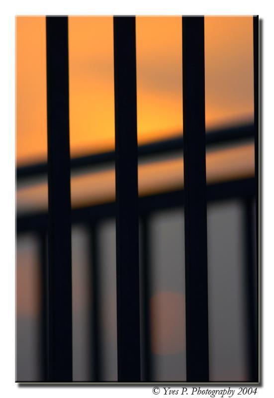 Sunset thru the gate ...