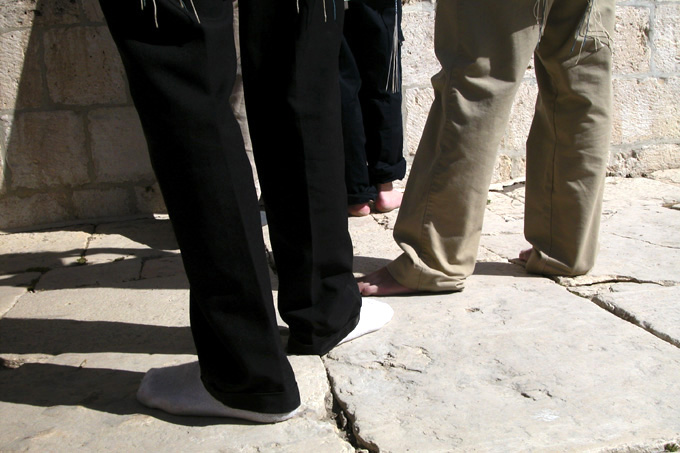 Religoius Jews are forbidden by Jewish law to wear leather footware on the Mount because of its Holiness