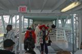 A steady stream of costumed revelers boards the ferry