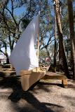 dugout canoe with sail