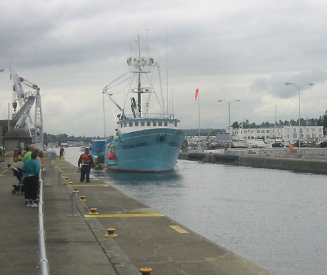 Boat heading through the Locks out to sea
