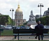 Studying the morning paper near Les Invalides