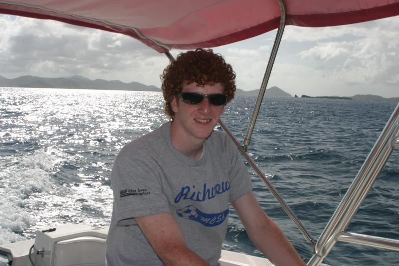 Shawn captains our boat towards St. John