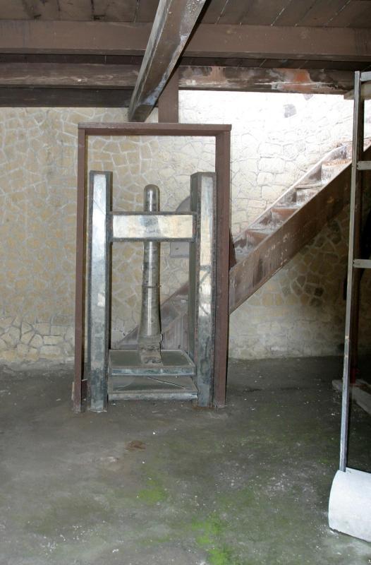 Clothes press - the original wood is encased in plexiglass.