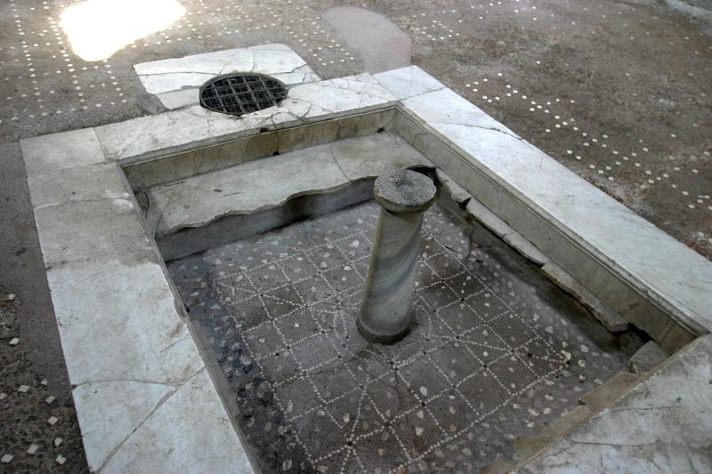 A remodeled pool. The original tile is on the bottom. The marble (now broken) was installed later.