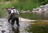 Brian and Katrina with seine net at Jock River Landing