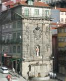 A shrine built into the side of a building