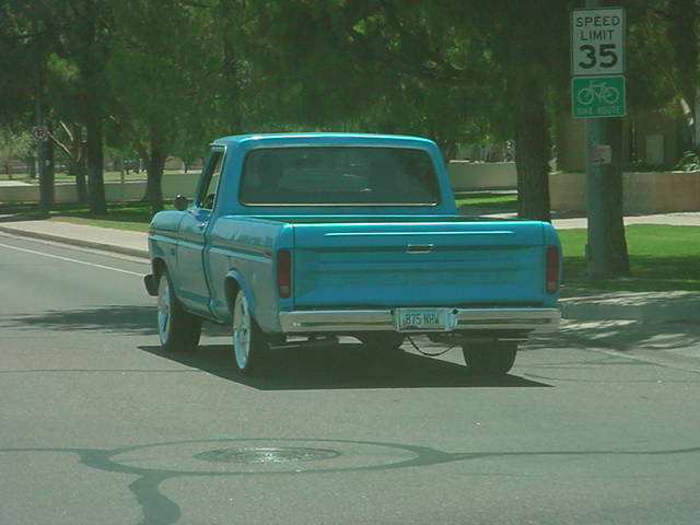 blue Ford F-100<br>with beautiful mags