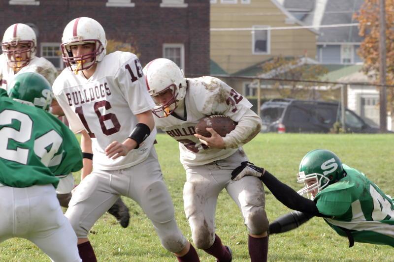 Jim Kvassay making a tackle