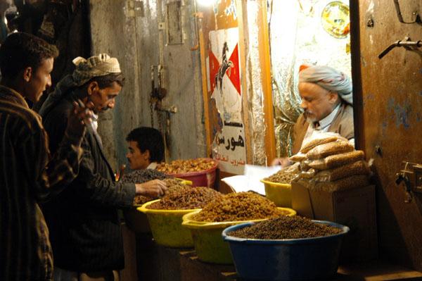 Sanaa souq stall lit at night