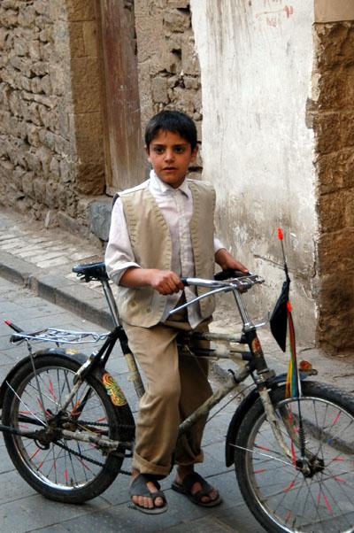 Boy pausing on a bike