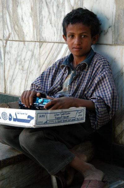 Boy selling things near Tahrir Sq.