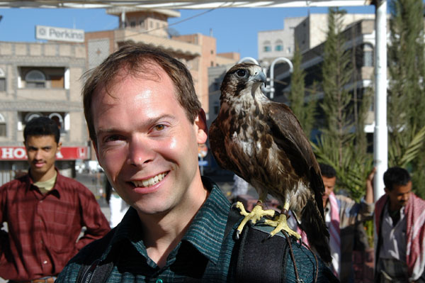 Roy with a small falcon, Tahrir Square