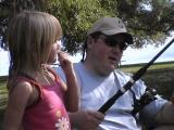 Mike shows Kaelyn how to fish